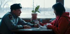 """When Kumiko (Rinko Kikuchi, right), a would-be Japanese fortune seeker, finds herself out of her element in the wilds of Minnesota, she receives help from a sincere yet clueless sheriff's deputy (David Zellner, left) in """"Kumiko, the Treasure Hunter."""" Photo by Sean Porter, courtesy of Amplify Releasing."""