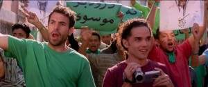 """During the 2009 Iranian presidential election campaign, student activists like Afshin Ghaffarian (Reece Ritchie, right) and his friend, Ardi (Tom Cullen, left), joined the opposition """"Green Movement"""" seeking to oust incumbent Mahmoud Ahmadinejad in favor of reform candidate Mir-Hossein Mousavi, as depicted in the new historical drama, """"Desert Dancer."""" Photo courtesy of Desert Dancer Production LTD."""