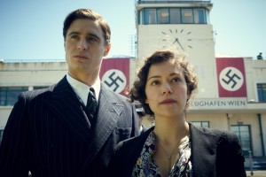 """In her younger days, Jewish refugee Maria Altmann (Tatiana Maslany, right) and her husband, Fritz (Max Irons, left), flee their native Vienna in the days leading up to World War II with the advance of Nazi occupying forces in the inspiring new historical drama, """"Woman in Gold.""""  Photo courtesy of The Weinstein Company."""