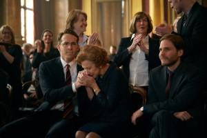 """Attorney Randy Schoenberg (Ryan Reynolds, left) and refugee-turned-activist Maria Altmann (Helen Mirren, center), aided by investigative journalist Hubertus Czernin (Daniel Brühl, right), take on the Austrian government to seek restitution for an improperly acquired work of art in the inspiring new docudrama, """"Woman in Gold."""" Photo courtesy of The Weinstein Company."""