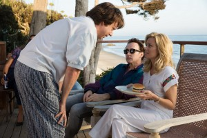 """Caught between the compassion of his new romantic interest, Melinda Ledbetter (Elizabeth Banks, right), and the questionable treatment tactics of his therapist, Dr. Gene Landy (Paul Giamatti, center), troubled Beach Boys founder Brian Wilson (John Cusack, left) struggles to find his way back from years of seclusion and breakdown in """"Love & Mercy."""" Photo by Francois Duhamel, courtesy of Roadside Attractions."""