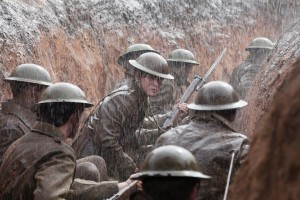 "While in the trenches, neophyte soldier Roland Leighton (Kit Harington, center) gets his first taste of combat during World War I in ""Testament of Youth."" Photo by Laurie Sparham, courtesy of Sony Pictures Classics."