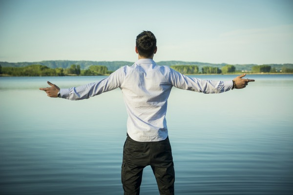 bigstock-Young-man-outdoor-with-arms-sp-90661217