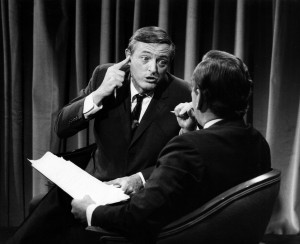 "Conservative pundit William F. Buckley Jr. (left) and liberal political commentator Gore Vidal (right, back to camera) hurl insults at one another during ABC television's groundbreaking coverage of the 1968 presidential nominating conventions, as seen in the often-contentious new documentary, ""Best of Enemies."" Photo courtesy of Magnolia Pictures."