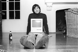 """Apple Computers co-founder Steve Jobs poses with one of his many technological creations in director Alex Gibney's engaging new documentary, """"Steve Jobs: The Man in the Machine."""" Photo courtesy of Magnolia Pictures."""