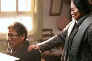 "Paroled radical Lu Yanshi (Lu) (Chen Daoming, left) returns to his beloved wife, Feng Wanyu (Yu) (Gong Li, right), only to find her suffering from severe amnesia in the heartfelt new love story, ""Coming Home"" (""Gui lai""). Photo by Bai Xiao Yan, courtesy of Sony Pictures Classics."