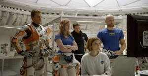 "The crew of the Ares III mission to Mars (from left, Matt Damon, Jessica Chastain, Sebastian Stan, Kate Mara, Aksel Hennie) faces a difficult decision when a severe windstorm threatens their settlement in ""The Martian."" Photo courtesy of Twentieth Century Fox Film Corporation."