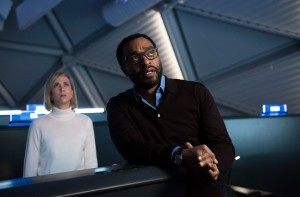 "Mars Mission Director Dr. Vincent Kapoor (Chiwetel Ejiofor, right) and NASA media coordinator Annie Montrose (Kristen Wiig, left) must handle some thorny issues when faced with unexpected news – and challenges – in ""The Martian."" Photo courtesy of Twentieth Century Fox Film Corporation."