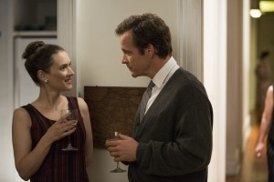 """Psychology professor Stanley Milgram (Peter Sarsgaard, right) meets his future wife, Sasha (Winona Ryder, left), for the first time in director Michael Almereyda's """"Experimenter."""" Photo courtesy of Magnolia Pictures."""