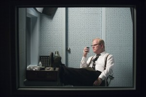 """In a controversial obedience experiment, """"victim"""" James McDonough (Jim Gaffigan) pretends to receive painful electric shocks in a room separated from the one allegedly issuing them in order to gauge the reaction of the test subject supposedly inflicting them, as depicted in the refreshingly witty new biopic, """"Experimenter."""" Photo courtesy of Magnolia Pictures."""