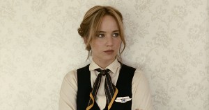 """As a frustrated airline ticket counter agent, Joy (Jennifer Lawrence) desperately looks to change her life in director David O. Russell's latest release, """"Joy."""" Photo courtesy © Twentieth Century Fox Film Corporation."""