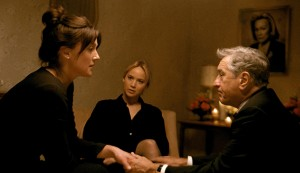 """Joy (Jennifer Lawrence, center), a budding entrepreneur and inventor, struggles to make her new business work while coping with the sometimes-helpful, sometimes-damaging involvement of dysfunctional family members like her father, Rudy (Robert De Niro, right), and half-sister, Peggy (Elisabeth Röhm, left), in the new comedy-drama, """"Joy."""" Photo courtesy © Twentieth Century Fox Film Corporation."""