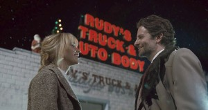"""Joy (Jennifer Lawrence, left), a budding entrepreneur and inventor, gets a big boost for her fledgling business with the assistance of cable television executive Neil Walker (Bradley Cooper, right) in """"Joy."""" Photo courtesy © Twentieth Century Fox Film Corporation."""