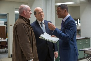"Allegheny County Coroner's Office colleagues Daniel Sullivan (Mike O'Malley, left), Dr. Cyril Wecht (Albert Brooks, center) and Dr. Bennet Omalu (Will Smith, right) discuss strategy for handling a particularly problematic autopsy case in director Peter Landesman's newest release, ""Concussion."" Photo courtesy © Columbia Pictures Industries, Inc."