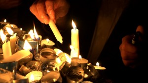 """The act of lighting candles in a Kabbalah ceremony, as seen in filmmaker Steven E. Bram's documentary, """"Kabbalah Me."""" Photo courtesy of First Run Features."""
