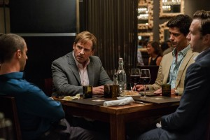 """Hedge fund manager Mark Baum (Steve Carell, second from left) investigates claims that the home mortgage market is about to collapse with the aid of his associates, Vinnie Daniel (Jeremy Strong, left), Porter Collins (Hamish Linklater, second from right) and Danny Moses (Rafe Spall, right), in """"The Big Short."""" Photo by Jaap Buttendijk, courtesy © Paramount Pictures."""