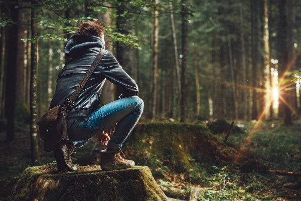 bigstock-Young-Man-Exploring-The-Forest-106016501