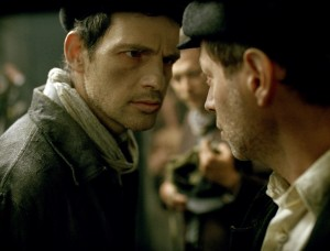 """Saul Ausländer (Géza Röhrig, left), a prisoner assigned to a special and particularly gruesome work detail at the infamous Auschwitz concentration camp, seeks to carry out a noble though seemingly impossible mission in the gripping new drama, """"Son of Saul."""" Photo courtesy of Sony Pictures Classics."""