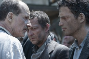 """Saul Ausländer (Géza Röhrig, right), a prisoner assigned to a special work detail at the infamous Auschwitz concentration camp, asks an unusual favor of a camp physician (Sándor Zsótér, left) who is also a prisoner in director László Nemes's debut feature, """"Son of Saul."""" Photo by Ildi Hermann, courtesy of Sony Pictures Classics."""