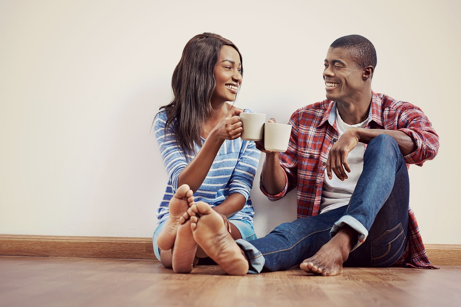 bigstock-Young-african-couple-sitting-o-73512694