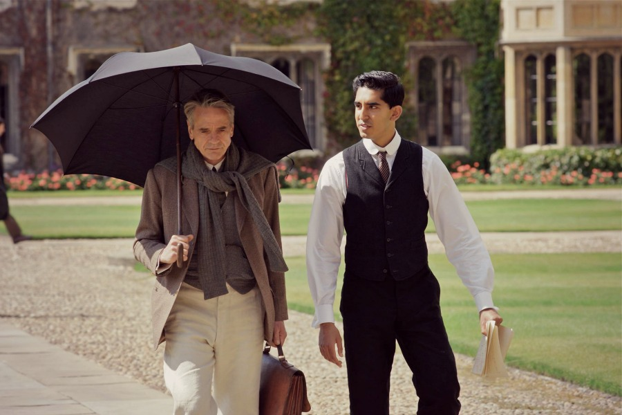 "Cambridge University professor G.H. Hardy (Jeremy Irons, left) and Indian mathematical genius Srinivasa Ramanujan (Dev Patel, right) discuss advanced numerical theory in ""The Man Who Knew Infinity."" Photo courtesy of Richard Blanshard, IFC Films."