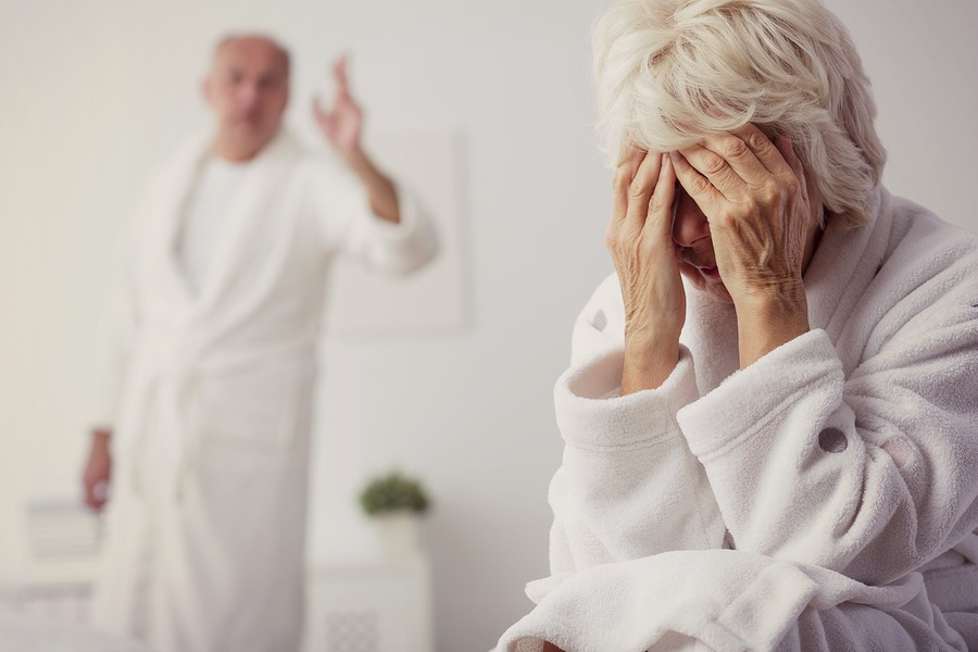 Elderly couple with marital problems arguing in bedroom